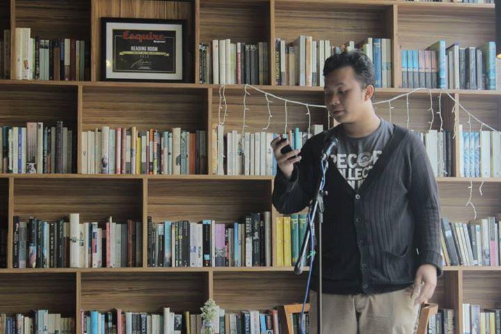 Raka Ibrahim reading aloud in Murmuration